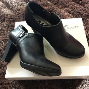 Black zip up ankle boots.